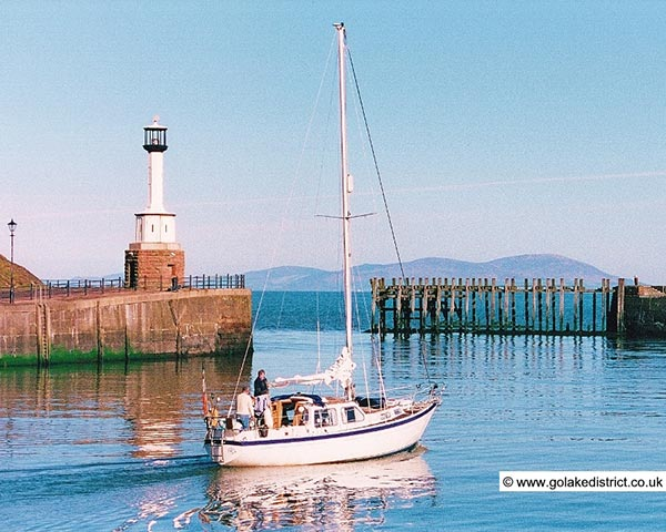 Yacht leaving Maryport Harbour, Cumbria